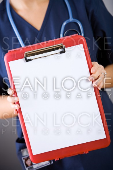 Nurse: Holding Out Blank Clipboard Stock Photography Content by Sean Locke