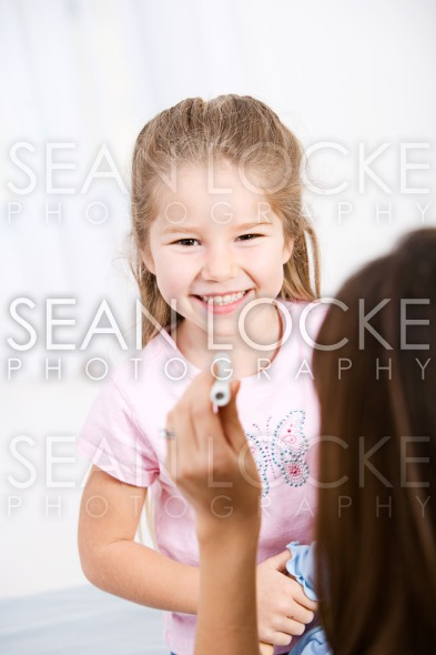 Nurse: Happy Child During Checkup Stock Photography Content by Sean Locke