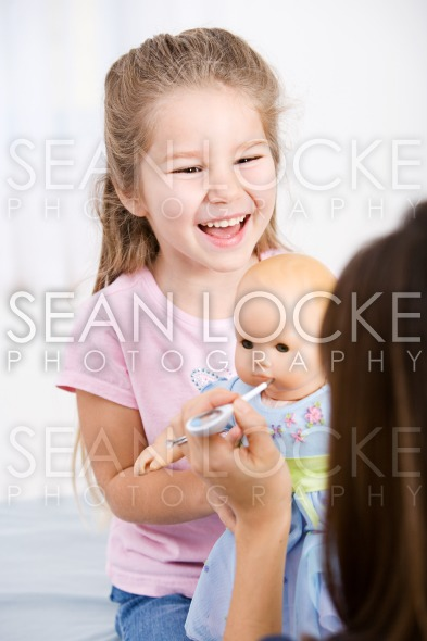 Nurse: Nurse Taking Temperature of Doll Stock Photography Content by Sean Locke