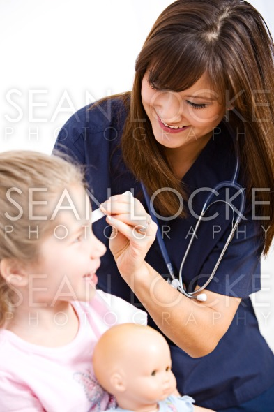 Nurse: Checking Child's Ears Stock Photography Content by Sean Locke