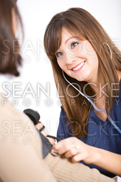 Nurse: Checking Patient Blood Pressure Stock Photography Content by Sean Locke