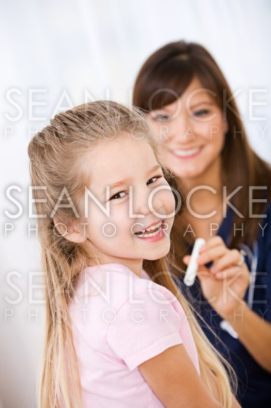 Nurse: Girl Happy to Be at Check Up Stock Photography Content by Sean Locke