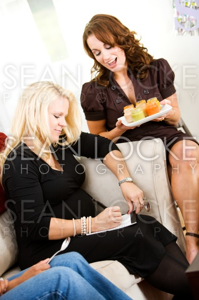 Baby Shower:  Writing Down a Food Flavor Guess Stock Photography Content by Sean Locke