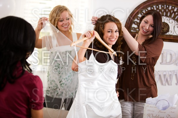 Bridal Shower: Happy Bride and Friends with Gown Stock Photography Content by Sean Locke