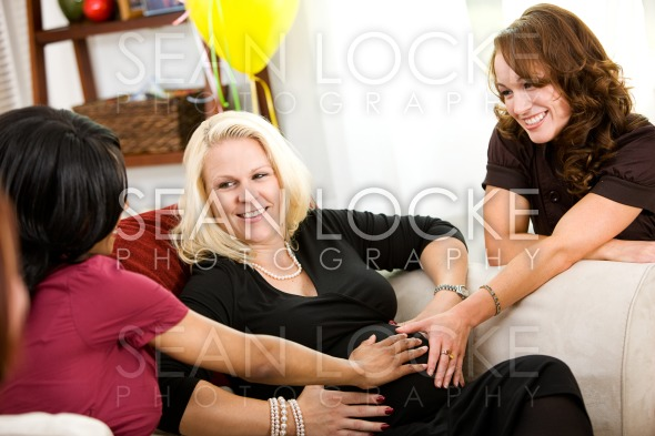 Baby Shower: Friends Feeling the Baby Moving Stock Photography Content by Sean Locke