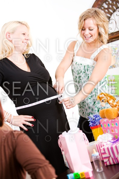 Baby Shower: Measuring the Size of Mom's Tummy Stock Photography Content by Sean Locke