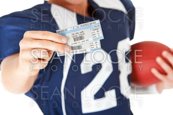 Football: Holding Game Day Tickets Stock Photography Content by Sean Locke
