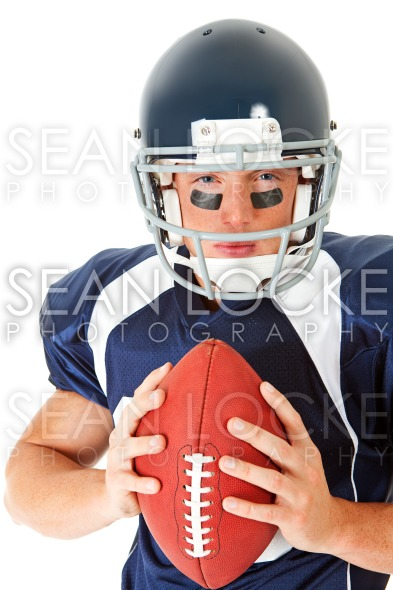 Football: Serious Player with Ball Stock Photography Content by Sean Locke