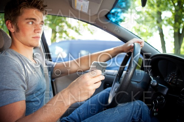 Driving: Trying to Text and Drive Stock Photography Content by Sean Locke