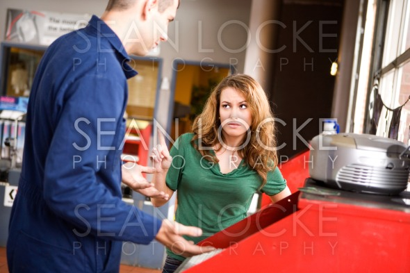 Mechanic: Woman Feels She Is Being Ripped Off Stock Photography Content by Sean Locke