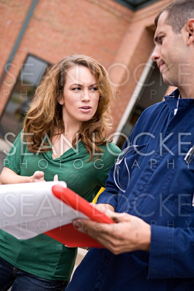 Mechanic: Woman Questions Repair Bill Stock Photography Content by Sean Locke