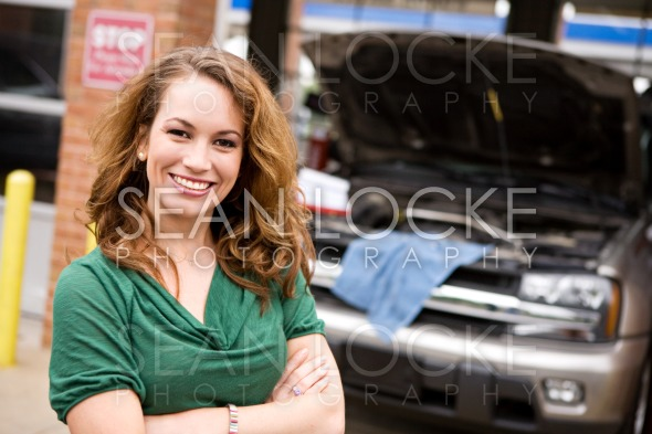 Mechanic: Cheerful Auto Shop Customer Stock Photography Content by Sean Locke