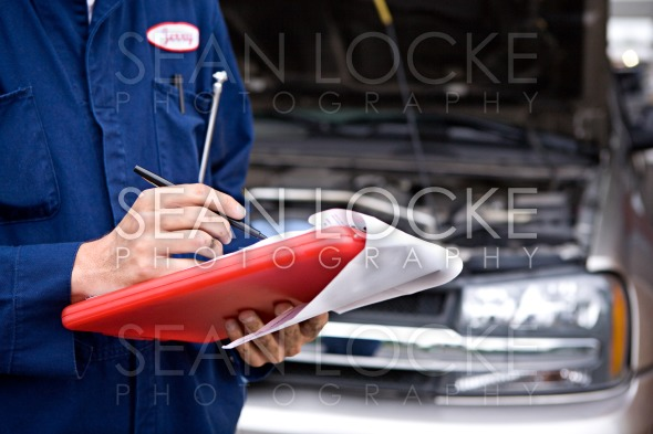 Mechanic: Writing On Clipboard Stock Photography Content by Sean Locke