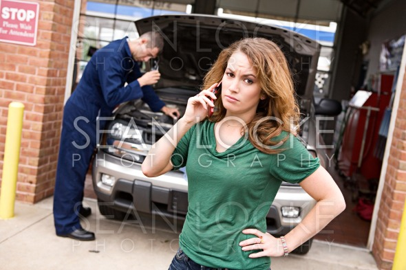 Mechanic: Woman Angry At Repair Cost Stock Photography Content by Sean Locke