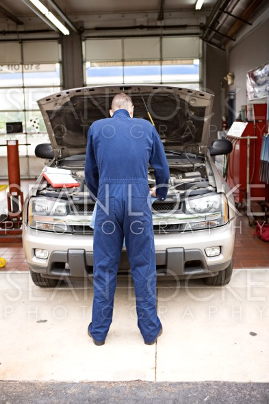 Mechanic: Checking Out the Engine Stock Photography Content by Sean Locke