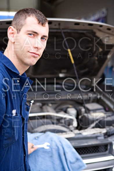 Mechanic: Trustworthy Mechanic By SUV Stock Photography Content by Sean Locke