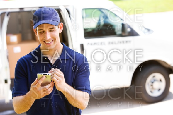 Delivery: Man Tracking Shipment with Van Behind Stock Photography Content by Sean Locke