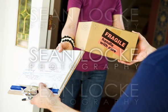Delivery: Delivering a Fragile Package Stock Photography Content by Sean Locke