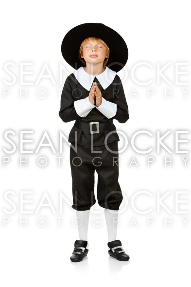 Thanksgiving: Pilgrim Boy Praying Stock Photography Content by Sean Locke