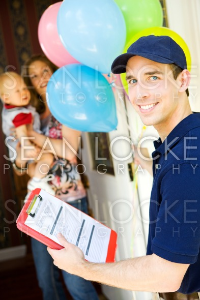 Delivery: Deliveryman with Balloon Bouquet Stock Photography Content by Sean Locke