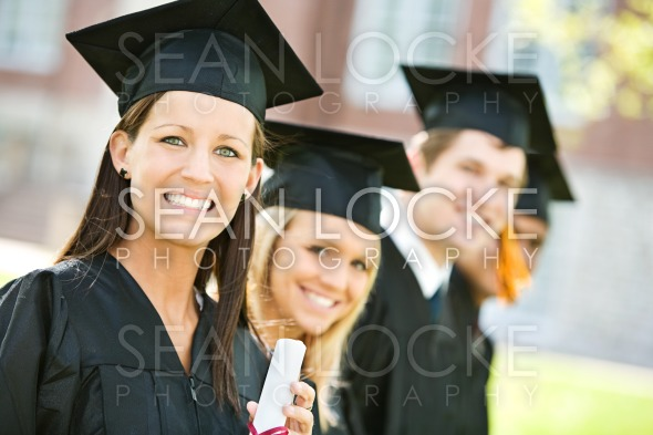 Graduation: Line of Graduates Look to Camera Stock Photography Content by Sean Locke