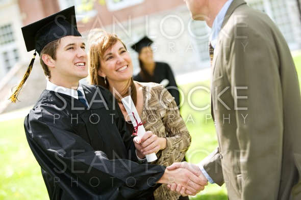 Graduation: Mother Stands By Son with Pride Stock Photography Content by Sean Locke
