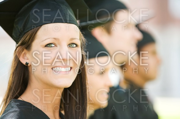 Graduation: Pretty Graduate Looks At Camera Stock Photography Content by Sean Locke