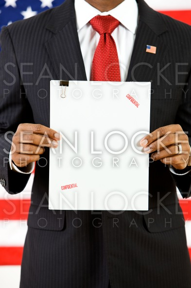 Politician: Holding Up Top Secret Document Stock Photography Content by Sean Locke
