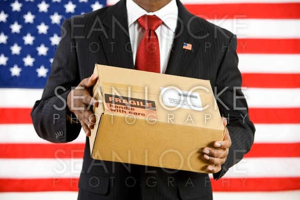 Politician: Holding a Cardboard Box to Ship Stock Photography Content by Sean Locke