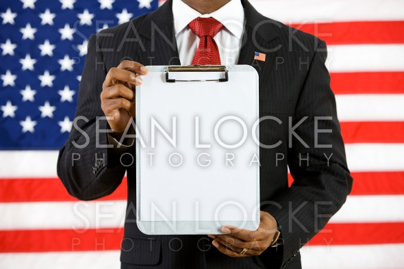 Politician: Holding Up a Clipboard with Blank Paper Stock Photography Content by Sean Locke