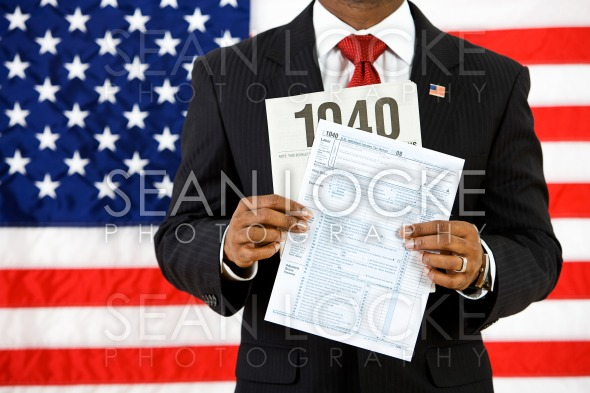 Politician: Holding Up the US Income Tax Form Stock Photography Content by Sean Locke