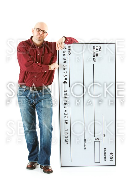 Check: Man Ready to Cash Huge Check Stock Photography Content by Sean Locke