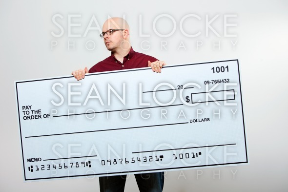 Check: Serious Man With Check Glances to Side Stock Photography Content by Sean Locke
