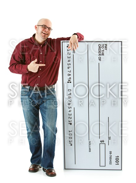 Check: Man Stands Next to Huge Bank Check Stock Photography Content by Sean Locke