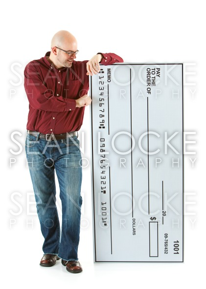 Check: Bald Man Looks At Novelty Sized Check Stock Photography Content by Sean Locke