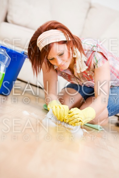 Cleaning: Woman Scrubbing the Floors Stock Photography Content by Sean Locke