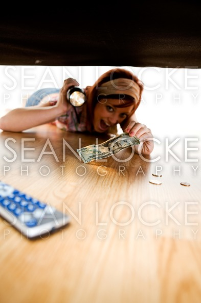 Cleaning: Maid Finds Money Under the Couch Stock Photography Content by Sean Locke
