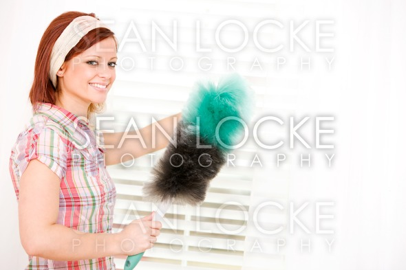 Cleaning: Woman Cleaning Window Blinds Stock Photography Content by Sean Locke