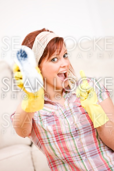 Cleaning: Holding Up Soapy Scrub Brush Stock Photography Content by Sean Locke