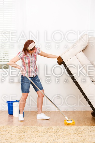 Cleaning: Lifting a Couch to Clean Under Stock Photography Content by Sean Locke