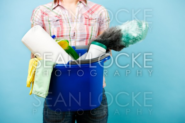 Cleaning: Woman Holds Bucket of Cleaning Supplies Stock Photography Content by Sean Locke