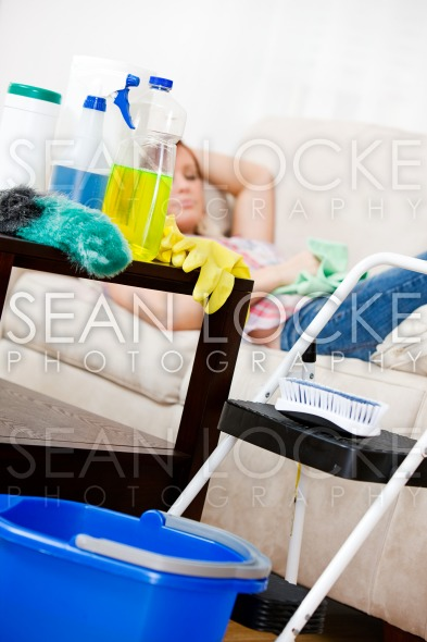 Cleaning: Cleaning Supplies with Woman Sleeping Stock Photography Content by Sean Locke