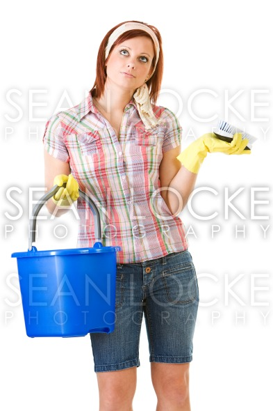 Cleaning: Woman Bored with Spring Cleaning Stock Photography Content by Sean Locke