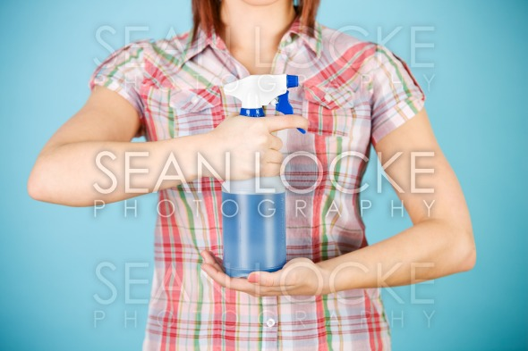 Cleaning: Woman Holding Sprayer of Liquid in Front Stock Photography Content by Sean Locke