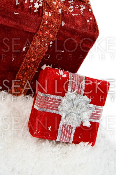 Christmas: Gift Boxes Sitting In Snow Stock Photography Content by Sean Locke