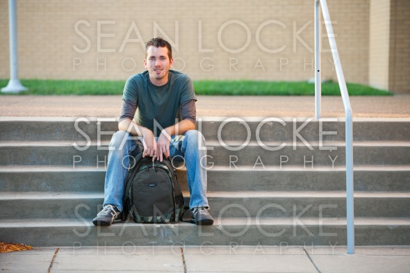 College: Cheerful Student on Steps Stock Photography Content by Sean Locke