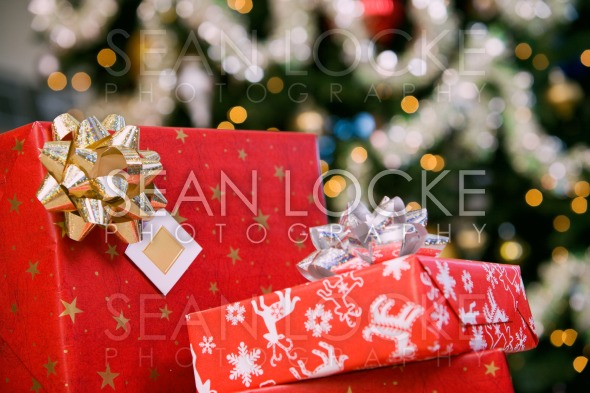 Party: Stack of Christmas Gifts By Tree Stock Photography Content by Sean Locke