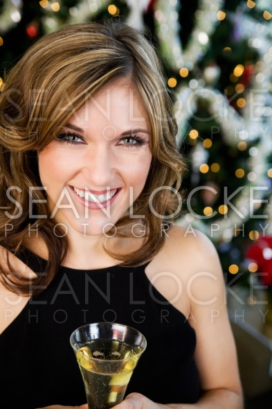 Party: Pretty Woman In Fancy Dress By Christmas Tree Stock Photography Content by Sean Locke