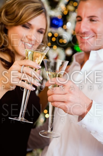 Party: Couple Toasting With Champagne By Christmas Tree Stock Photography Content by Sean Locke