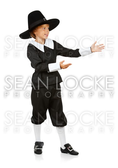 Thanksgiving: Boy Pilgrim Gestures to Side Stock Photography Content by Sean Locke